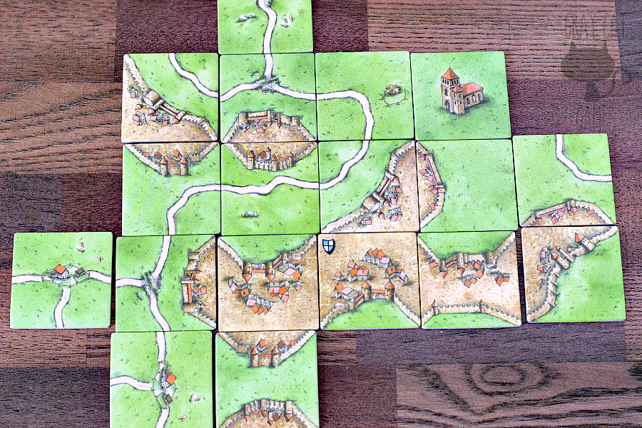 Carcassonne is a modern classic euro game with easy-to-learn rules and beautiful aesthetics. It's a great two-player game if you want some cutthroat strategy, and it plays really well with 3-4, as well.